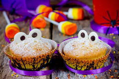 Halloween funny monster muffins with chocolate eyes for treat ki Stock Images