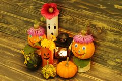 Halloween. Funny pumpkins with caps, charming ghosts, colorful ornamental pumpkins of unusual shape and black metal lantern with l stock image