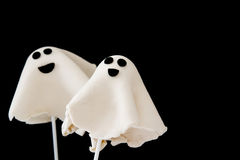 Halloween ghost cake pops on black background Stock Images