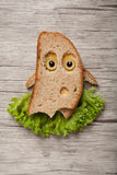 Halloween ghost made of bread and salad. On desk Royalty Free Stock Image
