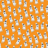 Halloween ghost on orange background Stock Photography