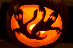 Halloween ghost pumpkin. Carving with candle inside Stock Images