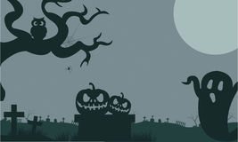 Halloween ghost and pumpkins in tomb at the night Royalty Free Stock Photo