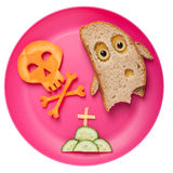 Halloween ghost and skull made of bread and carrot Stock Photos