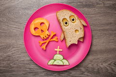 Halloween ghost and skull made of bread and carrot Royalty Free Stock Image