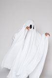 Halloween ghost. Young child dressed as a ghost  for halloween Royalty Free Stock Images