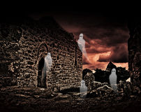 Halloween ghosts in cemetery Royalty Free Stock Images