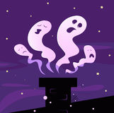 Halloween ghosts flying around chimney Stock Image