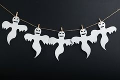 Halloween ghosts. Hanging on black background Royalty Free Stock Images