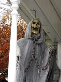 Halloween Ghoul. Halloween display of a skeleton in chains on a front porch to scare the children on Halloween stock image