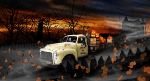 Halloween Ghouls Driving Old Delivery Truck. Two Halloween Ghouls driving old flatbed delivery truck filled with crates and pumpkins down dead tree lined road Royalty Free Stock Images
