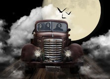 Halloween Ghouls Joyriding in Truck. Three Halloween Ghouls joyriding in old GMC truck with full moon, clouds and bats in background stock photos