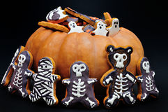 Halloween Gingerbreads&Pumpkin. A crowd of gingerbread ghosts on top of a pumpkin, surrounded by gingerbread skeleton and mummy bears/men Stock Image