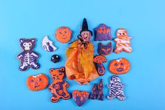 Halloween Gingerbreads and Witch. Set of various gingerbread dedicated to Halloween shapes on a blue background in studio stock image
