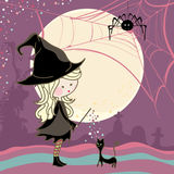 Halloween girl and cat. Cute girl in halloween costume cast a spell on her cat Stock Photography