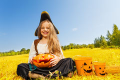 Halloween girl in costume of a pirate sitting Royalty Free Stock Photos