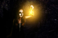 Halloween. Girl with a flashlight in his hand Stock Photo