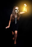 Halloween. Girl with a flashlight in his hand Stock Photos