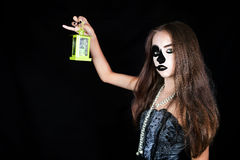 Halloween. Girl with a flashlight in his hand Royalty Free Stock Image