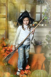 Halloween girl. Girl in hat of witch Royalty Free Stock Photos