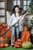 Halloween girl. Girl in hat of witch and  orange pumpkins Royalty Free Stock Images