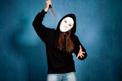 Halloween girl with mask and knife Royalty Free Stock Photo
