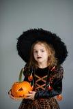 Halloween. Girl portray evil sorceress. Royalty Free Stock Image