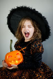 Halloween. Girl portray evil sorceress Royalty Free Stock Photos