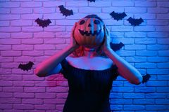 Halloween girl with pumpkin head partying in a nightclub. Hallow. Een, celebration, party concept Stock Image