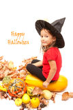 Halloween girl with pumpkins Royalty Free Stock Images