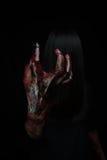 Halloween girl with scary hand fierce. Halloween girl with scary hand stock photography