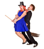 Halloween girl witch on broom with man. Stock Photography