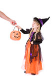 Halloween: Girl Witch Trick Or Treating For Candy Stock Images