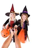 Halloween: Girls Get Halloween Treats From Anonymous Adult royalty free stock images