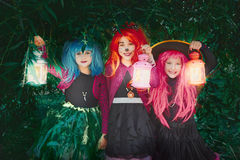 Halloween girls with lanterns Royalty Free Stock Photos