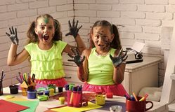 Halloween girls with scary faces colored with paints. Children with zombie painted hands. Kids learning and playing. Body art and painting. Entertainment royalty free stock photography