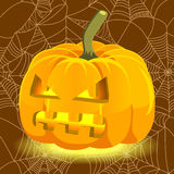 Halloween glowing pumpkin with evil face Royalty Free Stock Photos