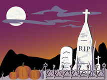 Halloween Graveyard. Graveyard with RIP grave plus others behind a wrought iron fence with pumpkins on a spooky night Royalty Free Stock Image