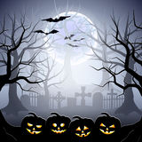 Halloween graveyard and pumpkins in foggy forest Stock Photography
