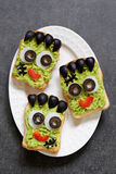 Halloween green monster sandwich. Avocado toast look like as green monster for Halloween Royalty Free Stock Photography