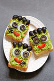 Halloween green monster sandwich. Avocado toast look like as green monster for Halloween Royalty Free Stock Image