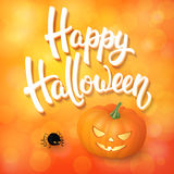 Halloween greeting card with pumpkin, angry spider and 3d brush lettering on orange background with bokeh elements. Decoration for poster, banner, flyer design Royalty Free Stock Photography