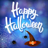 Halloween greeting card with witch hat, angry spiders and 3d brush lettering on blue background with bokeh elements Royalty Free Stock Image
