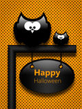 Halloween greetings card with cartoon owls Stock Photo