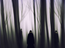Halloween Grim Reaper silhouettes abstract background. Stock Photo