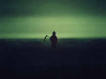 Halloween Grim Reaper silhouettes abstract background. Royalty Free Stock Images