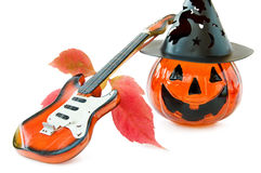 Halloween guitar and pumpkin. Halloween song with guitar and pumpkin candle. Isolated on white background stock photo