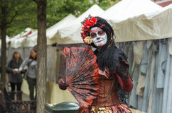 Halloween Gypsy Woman. A woman is wearing a traditional flamenco cloth at halloween stock photos