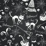 Halloween hand drawing doodles on black chalkboard Royalty Free Stock Image