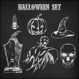 Halloween hand drawn set. On chalkboard background Stock Image